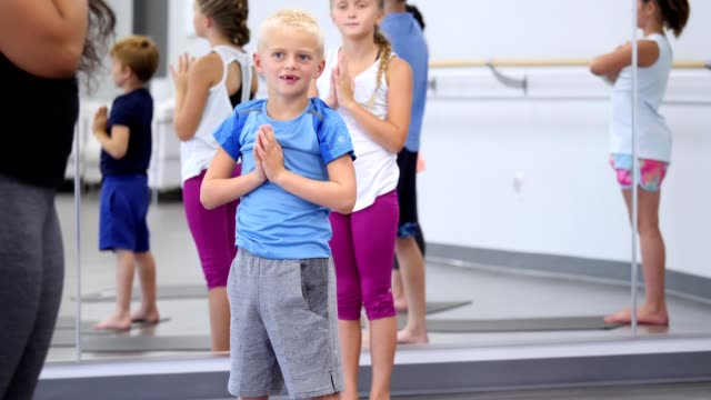 group of children in prayer position during yoga class - prayer position stock videos & royalty-free footage