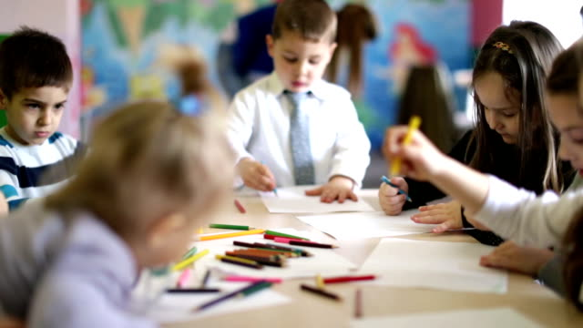 group of children in the classroom drawing - crayon stock videos and b-roll footage