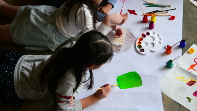 group of children painting and drawing on paper - art and craft stock videos & royalty-free footage