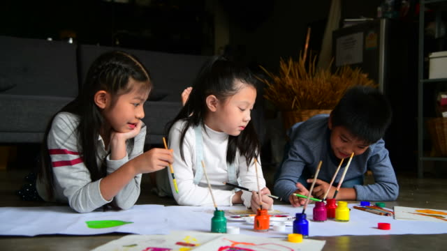 group of children painting and drawing on paper - sibling stock videos & royalty-free footage