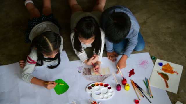group of children painting and drawing on paper - craft stock videos & royalty-free footage