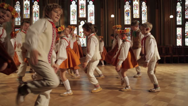 ws group of children performing dance in guild hall / riga, latvia - line stock videos & royalty-free footage