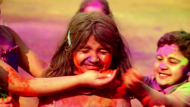 Group of children playing holi, Delhi, India