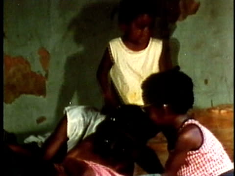 Group of children playing together in run down house/ USA/ AUDIO