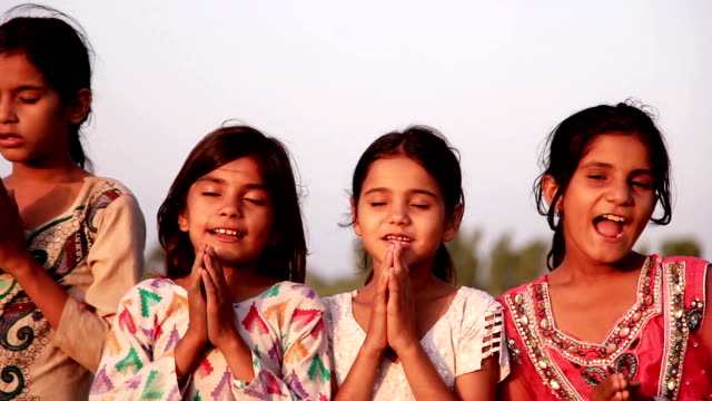 group of children praying outdoor in the nature - praying stock videos & royalty-free footage