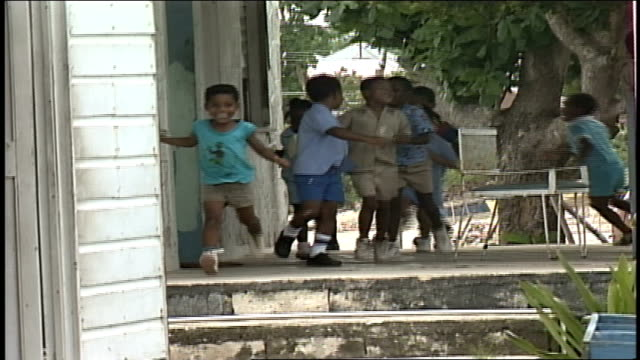 group of children running around and then posing on front stoop - jamaica stock videos & royalty-free footage