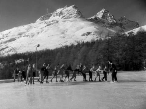 A group of children skate in single file during a skating lesson at Survetta Switzerland
