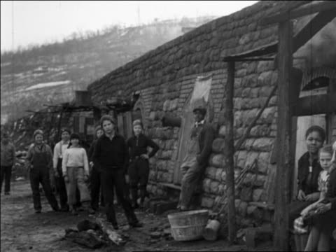 portrait group of children standing by coke ovens at coal mines / pennsylvania / newsreel - 1935 stock videos & royalty-free footage
