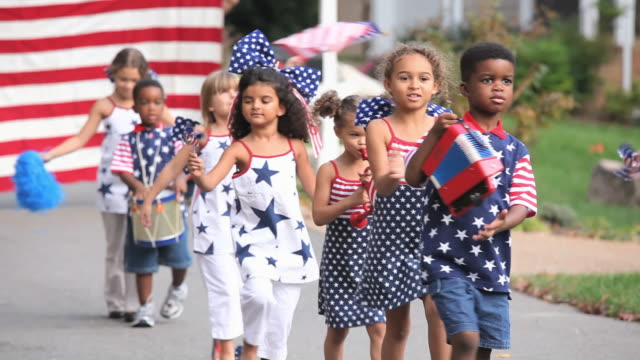 MS Group of children (2-7) walking in Independence Day parade / Richmond, Virginia, USA.