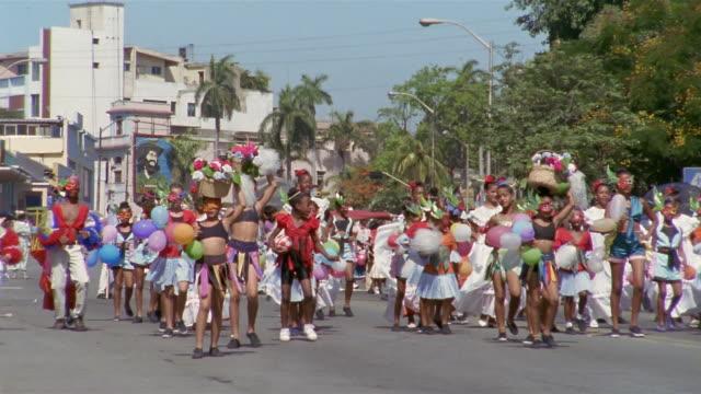 MS, PAN, Group of children with balloons in parade , Santiago de Cuba, Cuba