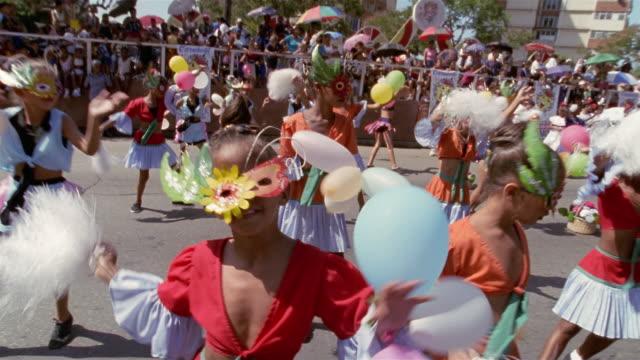 MS, CU, Group of children with balloons in parade, Santiago de Cuba, Cuba