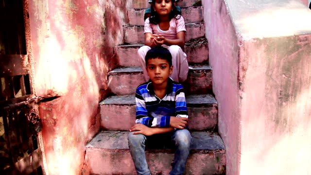 Group of children's sitting in stairs