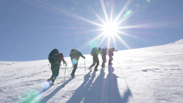 group of climbers are walking in the mountain peak - esplorazione video stock e b–roll