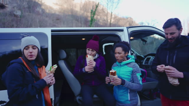 group of climbers eating during rest from extreme rock climbing - protein bar stock videos & royalty-free footage