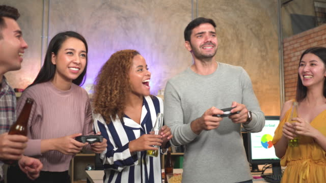 group of colleagues having a party and playing a game after working in office - employee engagement stock videos & royalty-free footage