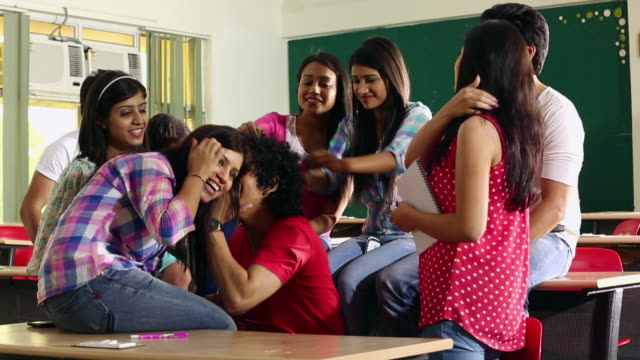 Group of college students enjoying in the classroom