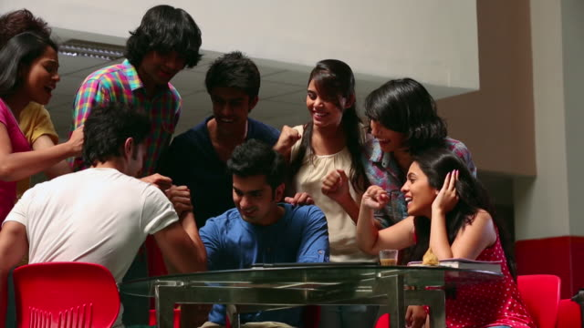 Group of college students enjoying in the college