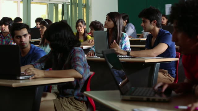 Group of college students studying in the classroom