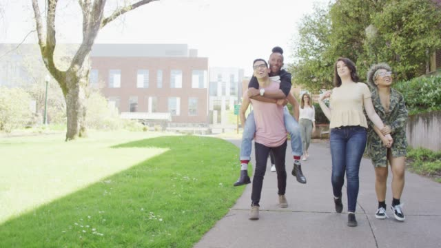 group of college students walking - piggyback stock videos and b-roll footage