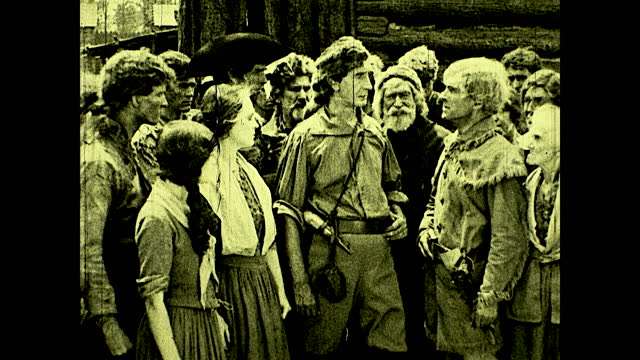 group of colonists surrounding woman crying over murdered man; colonists complaining to daniel boone about the hardships. historical reenactment of... - surrounding stock videos & royalty-free footage