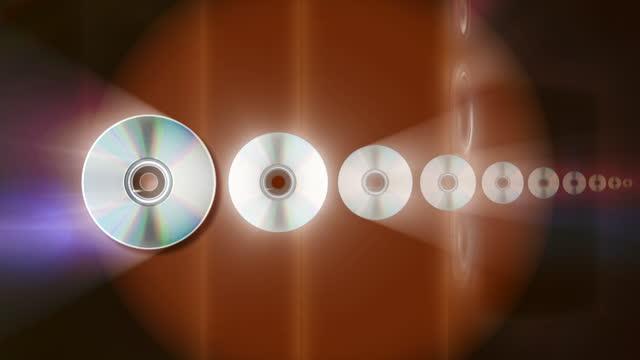 vídeos de stock, filmes e b-roll de group of compact discs, abstract background - dvd cd