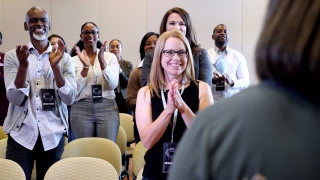 group of conference attendees applaud keynote speaker - public speaker stock videos & royalty-free footage