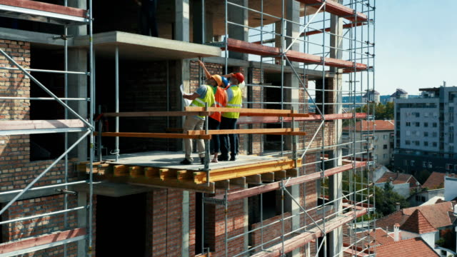 group of contractors at the construction site at the platform. - quality control stock videos & royalty-free footage