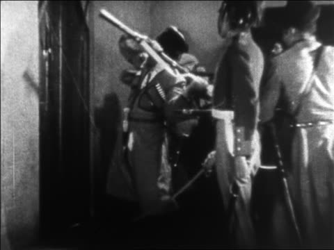 vídeos de stock e filmes b-roll de b/w 1925 group of cossacks banging on door with gun / feature - 1925