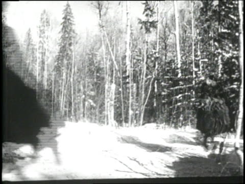 A group of Cossacks ride through a snowy forest