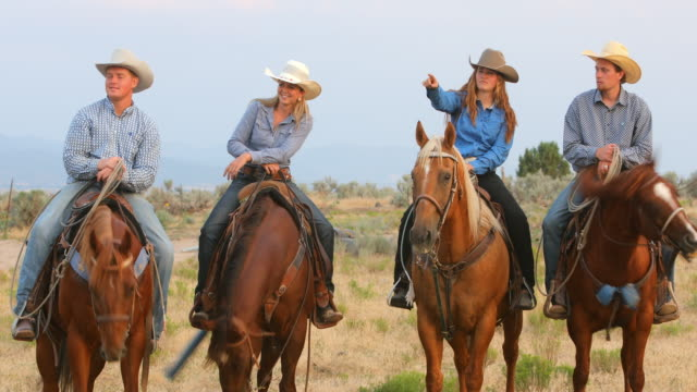 group of cowboys and cowgirls on horseback - cowgirl stock videos & royalty-free footage
