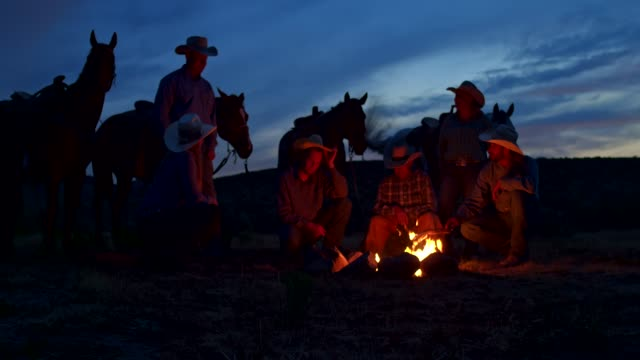 group of cowboys on a campfire in utah, usa - cowboy hat stock videos & royalty-free footage