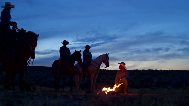 group of cowboys on a campfire in utah, usa - cowboy stock videos & royalty-free footage