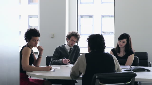 MS Group of coworkers in discussion at conference table/Seattle, Washington, USA
