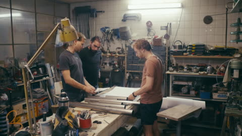 group of craftsmen designing new product in workshop - argentinian ethnicity stock videos & royalty-free footage
