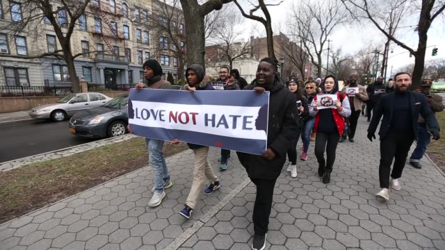 group of crowd march down on the brooklyn streets to raise awareness of no tolerance for violence or anti-semitism against jewish people. students... - prejudice stock videos & royalty-free footage