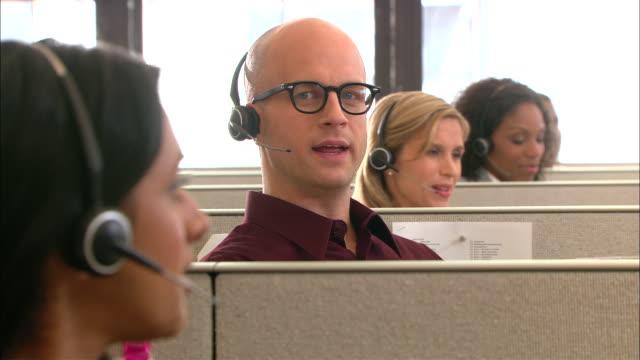 vídeos de stock e filmes b-roll de cu, selective focus, group of customer service representatives at work - call center