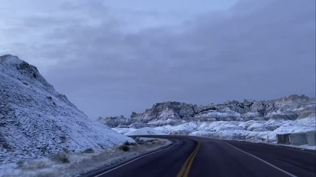 group of deer crossed a road in the snow-covered badlands national park on october 18. carol bauer was driving through the park when she captured the... - badlands national park stock videos & royalty-free footage