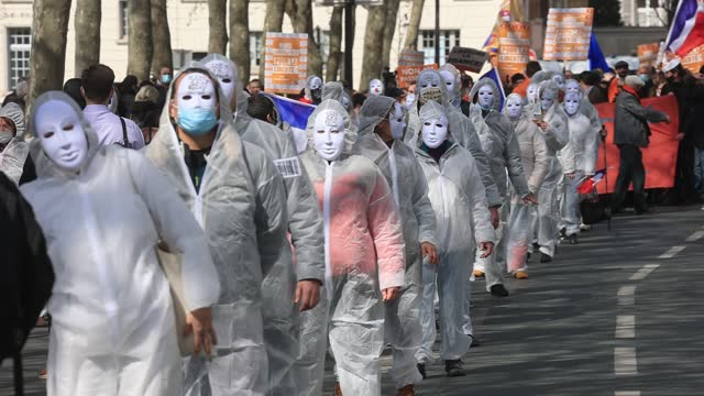 group of demonstrators wearing white outfits march during a rally against health restrictions initiated by the conservative political movement « les... - paranoia stock videos & royalty-free footage