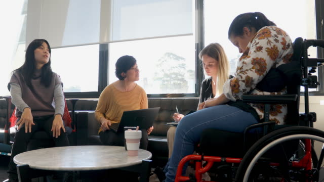 group of disabled women sitting down having a meeting - equal opportunity employer stock videos & royalty-free footage