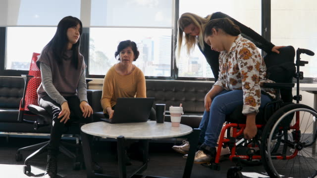 group of disabled women sitting down having a meeting - equal opportunities stock videos & royalty-free footage