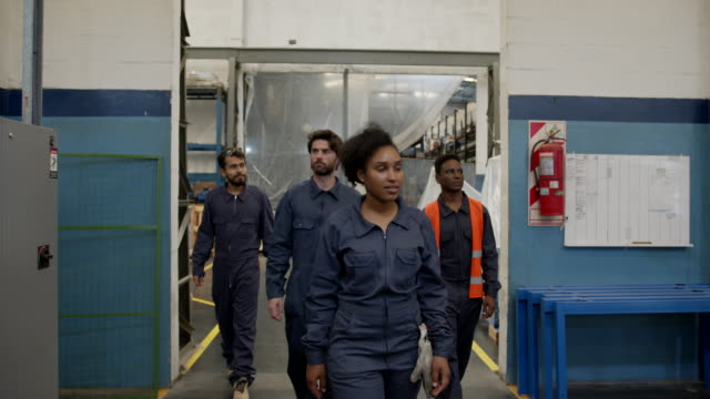 group of diverse industrial laborers walking into the factory ready to work - manufacturing occupation stock videos & royalty-free footage