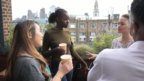 group of diverse millennials drinking coffee and chatting, slow motion video - social gathering stock videos & royalty-free footage