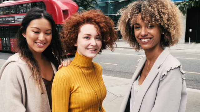 group of diverse millennials women together in the city - slow motion video - variation stock videos & royalty-free footage