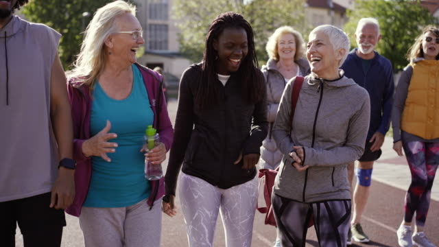group of diverse people walking together and talking after their dance class - health club stock videos & royalty-free footage