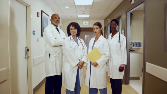 ms ds group of doctors standing in hospital hallway, looking at camera / edmonds, washington, usa - people in a line stock videos & royalty-free footage