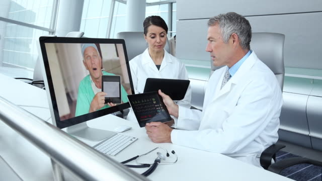 ws group of doctors video conferencing in corporate office, discussing patient medical information / virginia beach, virginia, united states - brown hair stock videos & royalty-free footage