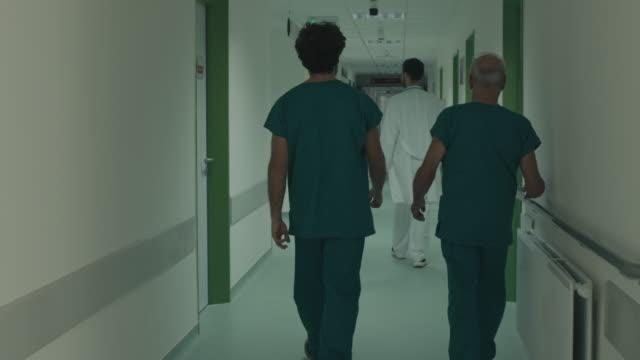 group of doctors walking - nurse walking stock videos & royalty-free footage