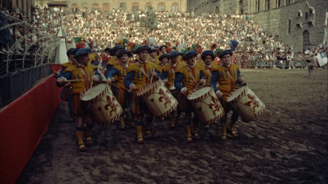 ms group of drummers marching on field  before football game / florence, italy - parade stock videos & royalty-free footage