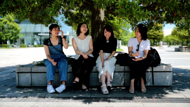 Group of dynamic Japanese woman having a fun discussion