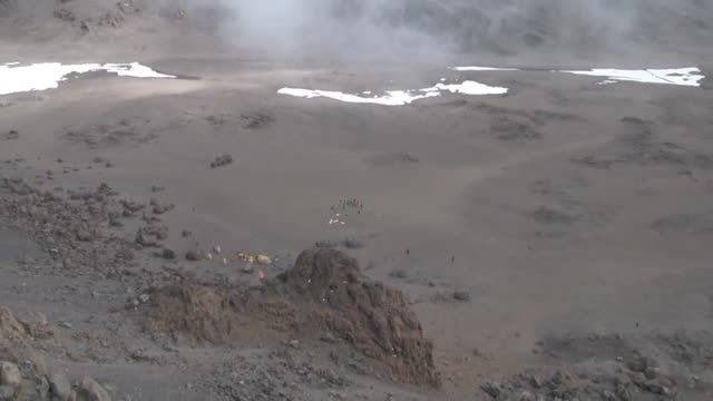 a group of eccentric international cricketers set a new record for the highest ever match with a lung busting effort at the top of mount kilimanjaro - international match stock videos & royalty-free footage